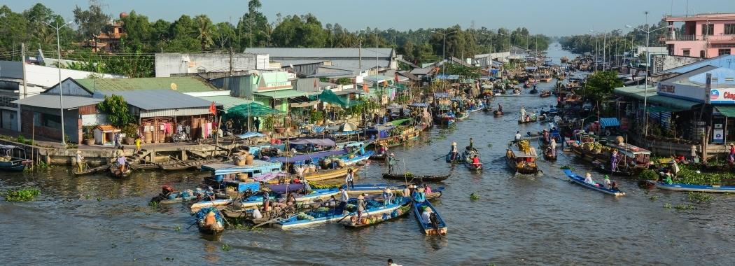 bigstock-Floating-Market-In-Mekong-Delt-201355237