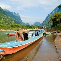 Mekong boat pulled up at shore