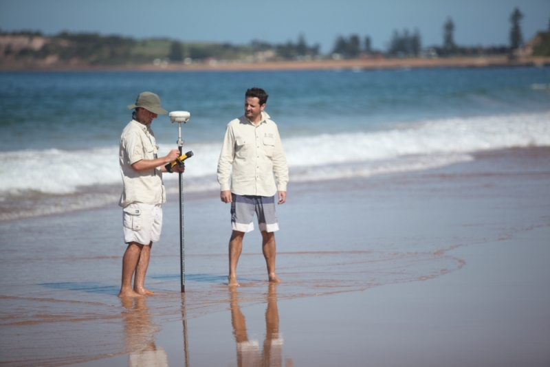 Matthew Phillips and Mitchell Harley surveying at Narrabeen beach. Photo by Larry Paice.