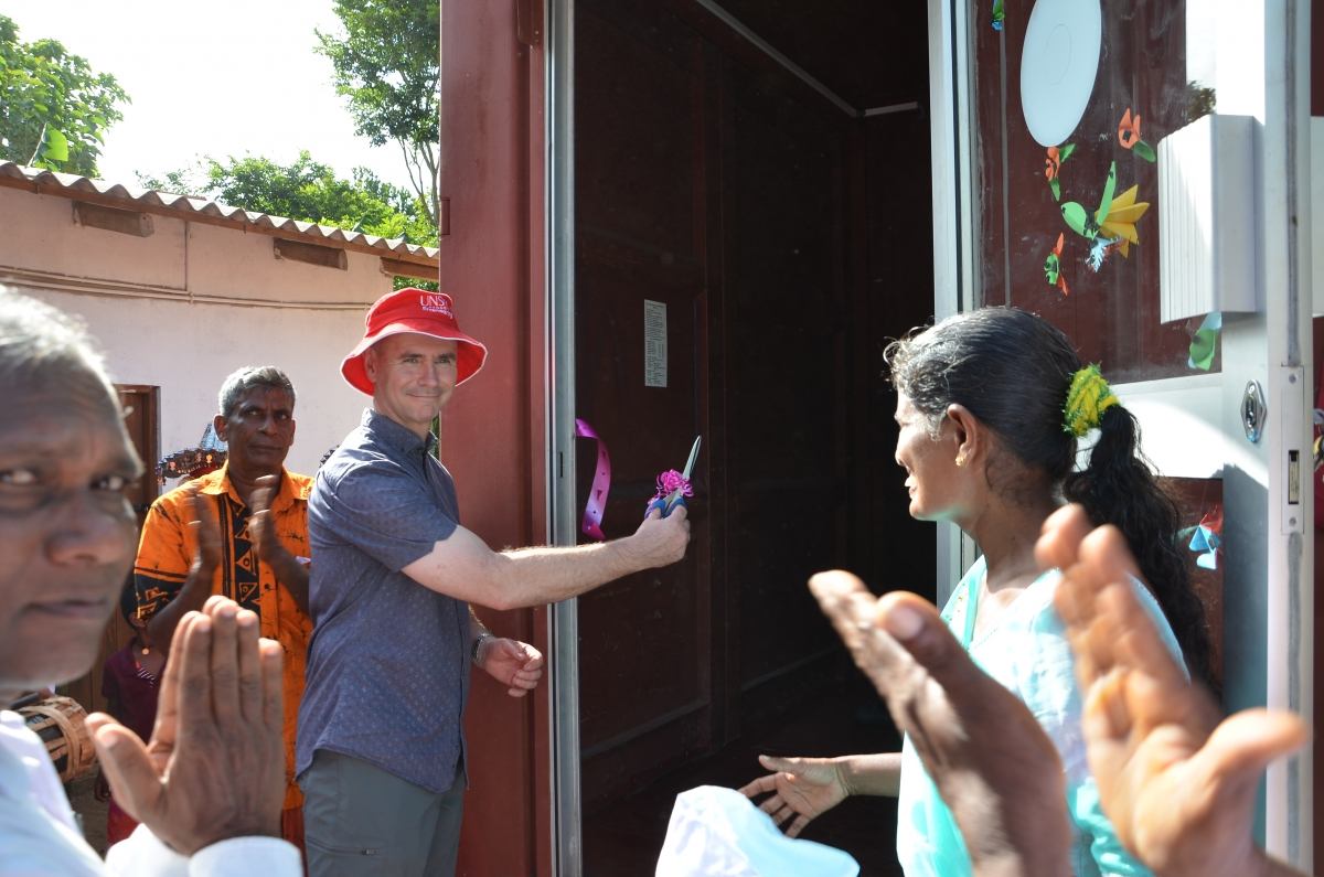 Prof Greg Leslie cuts the ribbon at the Pathuma RO opening ceremony